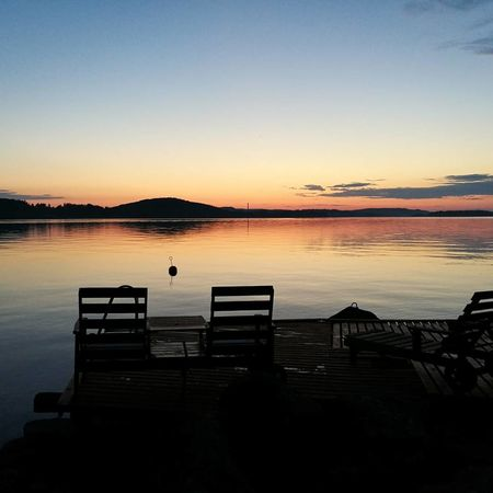 Sunset at friends summer cottage 😊 Sunset Scenics Tranquility Lake Beauty In Nature Idyllic Sky Silhouette Nature Tranquil Scene Landscape Water Reflection Outdoors No People Sunlight Blue Horizon Over Water Clear Sky Photograph Cloud - Sky