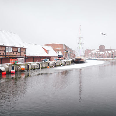 view of snow covered buildings in city Historical Building Mecklenburg-Vorpommern Winter Winterscapes Architecture Building Exterior Built Structure City Clear Sky Day Germany Harbor Moored Nautical Vessel No People Old Buildings Oldtown Outdoors Philipp Dase Sky Snow Covered Transportation Water Waterfront Winter In The City Wismar