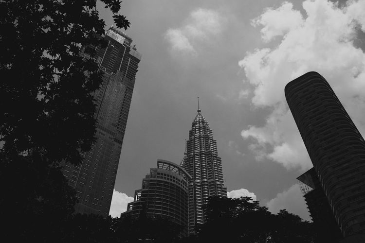Architecture Black And White Blackandwhite Building Exterior Built Structure City Day Growth Kuala Lumpur Low Angle View Modern No People Outdoors Petronas Towers  Sky Skyscraper Tall - High Tower Tree Walking In Kuala Lumpur