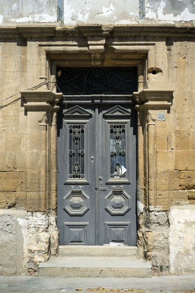 Arch Architecture Blue Building Exterior Built Structure Closed Day Door Entrance Exterior Façade History Outdoors Stone Material Traditional Greek Architecture Weathered