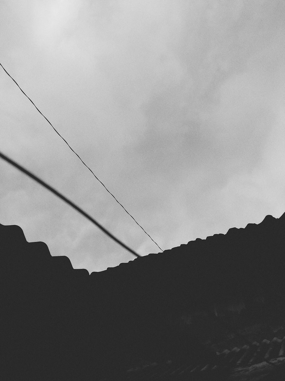 low angle view, sky, cable, silhouette, connection, no people, nature, outdoors, cloud - sky, beauty in nature, day