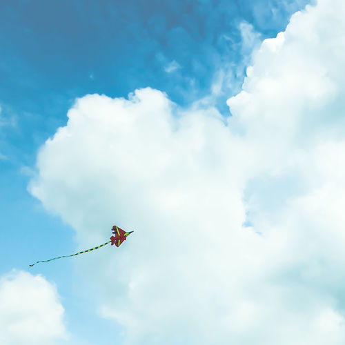 Fly high and touch the sky! Kite Blue Sky Cloud - Sky Clouds Day Fluffy Fluffy Clouds Low Angle View Nature No People Outdoors Sky The Great Outdoors - 2018 EyeEm Awards