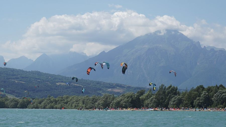Scenic view of sea and mountains against sky santa croce lake. veneto to discover.