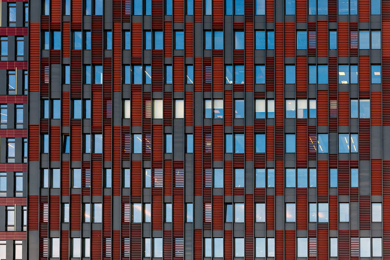Front view on a facade of modern office building as texture, background, abstract - Image No People Backgraund Wallpaper Pattern Texture Architecture Close-up Details Building Exterior Built Structure Building Full Frame Window Office Office Building Exterior City Backgrounds Day Red Modern Glass - Material Reflection Low Angle View Outdoors Skyscraper Apartment Repetition Façade Exterior Modern Office Home Abstarct High Construction Structure Business Residental Downtown Estate Front View Design Outdoor Block Steel Flat Cityscape Mirror Reflection Corporate City