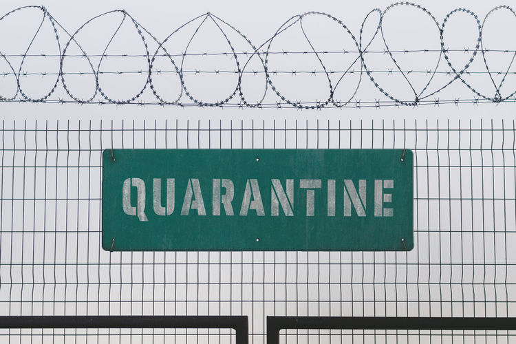 Information sign on chainlink fence