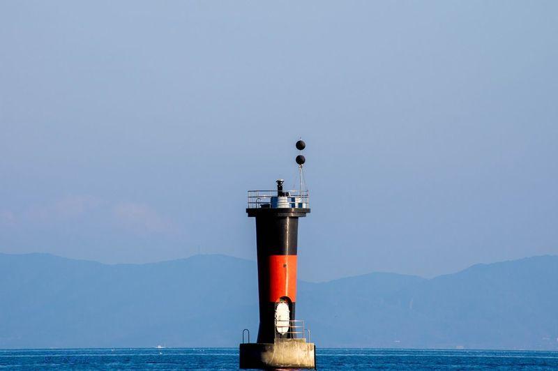 Beacon In Sea Against Sky
