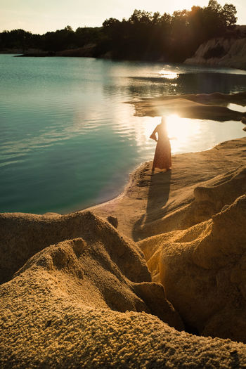 Sun goes down Sunset EyeEmNewHere Warm Water Lake Outdoors Nature One Person Adult Day Beauty In Nature Only Women People Colour Your Horizn