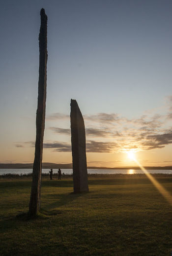 The Stones of Stenness, Orkney Ancient Orkney Stones Of Stenness Beauty In Nature Day Field Grass Landscape Monument Nature No People Outdoors Scenics Sky Standing Stones Sun Sunlight Sunset Tranquil Scene Tranquility