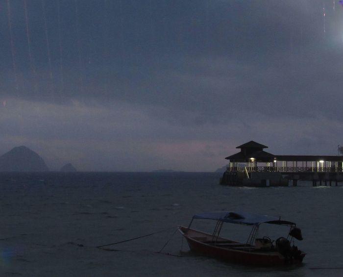 EyeEmNewHere Dark Malesia Rain Sandokan Beauty In Nature Boat Nature Outdoors Perenthian Perenthian Island Scenics Sea Sky Suggestive Place Thunderstorm Tropical Storm Water