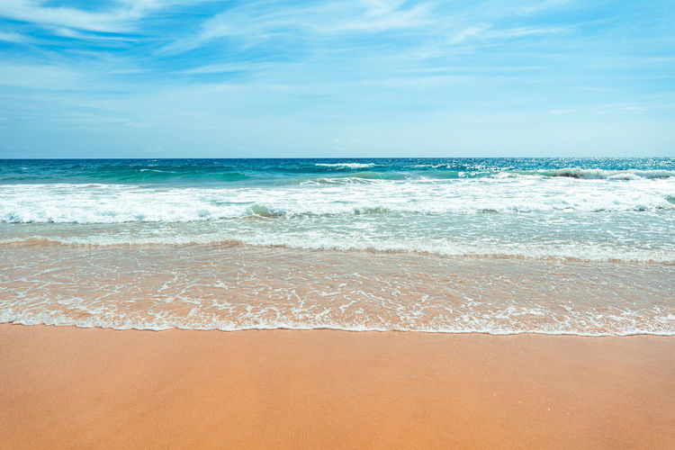 Sea beach Summer beach relaxing seaside Sea Beach Water Land Horizon Over Water Horizon Beauty In Nature Sky Scenics - Nature Wave Motion Sand Sport Aquatic Sport Idyllic Surfing Cloud - Sky Tranquility Nature Turquoise Colored