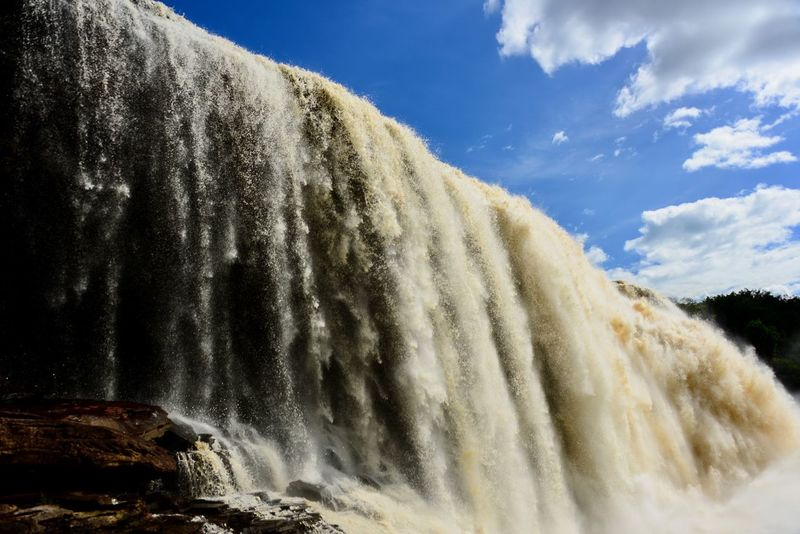 Salt el Sapo (Saho water fall) in Canaima National Park, Venezuela Beauty In Nature Blurred Motion Close-up Cloud - Sky Day Hot Spring Low Angle View Motion Nature No People Outdoors Power In Nature Salt El Sapo Scenics Sky Tannin Water Waterfall Waterfalls