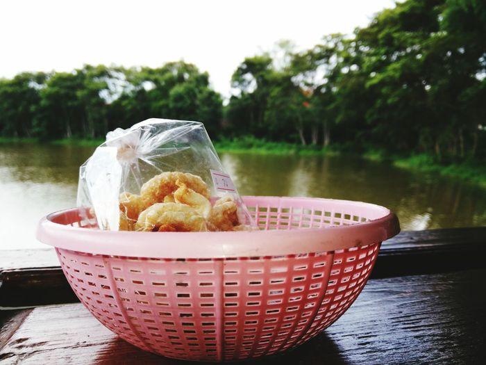 Plastic bag with food in colander