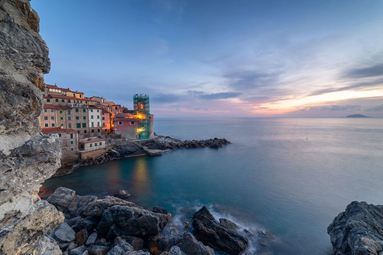 Tellaro, Liguria, Italy Architecture Water Building Exterior Sea Built Structure Sky Building Rock Rock - Object Cloud - Sky Nature Solid Scenics - Nature Beauty In Nature Beach Travel Destinations No People History Liguria Liguria,Italy Italy Italia La Spezia Lerici Tellaro Golfo Dei Poeti Poets Gulf Sunset Sunset_collection Sunset #sun #clouds #skylovers #sky #nature #beautifulinnature #naturalbeauty #photography #landscape EyeEm Best Shots EyeEm Nature Lover EyeEm Selects Nature Nature_collection Landscape Landscape_Collection Landscape_photography Travel Travel Photography