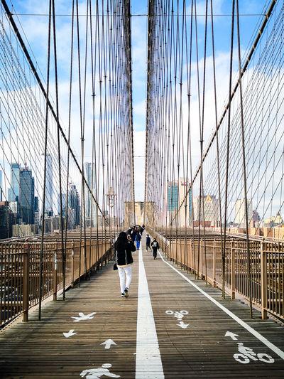 People walking on suspension bridge