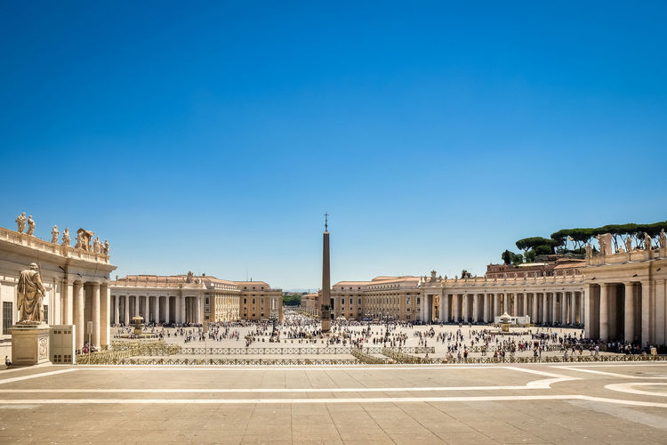 Historic building and obelisk at st peters square against clear blue sky
