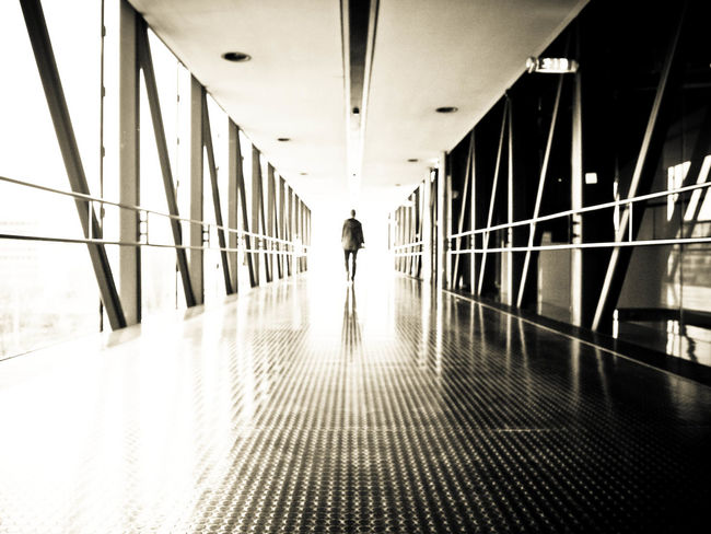 Alone Architecture Ceiling Corridor Day Diminishing Perspective Flooring Footbridge Full Length Indoors  Long Modern Narrow Passage Person Reflection Roadtonowhere Standing Target The Way Forward Young Adult