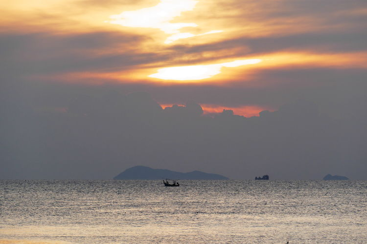 Orange Color Silhouette Non-urban Scene Idyllic Nature No People Waterfront Tranquility Sky Cloud - Sky Sunset Scenics - Nature Beauty In Nature Water Tranquil Scene Sea Outdoors Island Thai Fishing Boats Fishing Boats Evening Sky Shore Seascape Skyscape Dramatic Sky At Sunset Time Thailand_allshots
