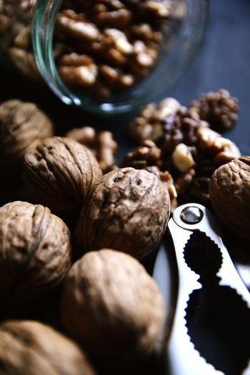 High Angle View Of Walnuts With Nutcracker