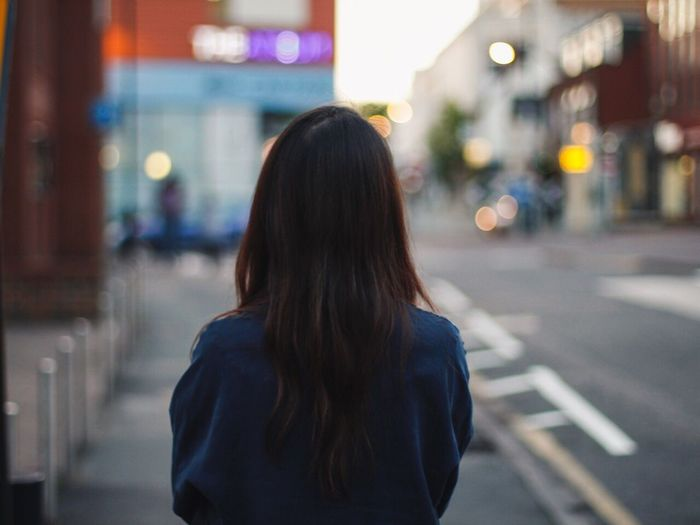 Rear View One Person Focus On Foreground Long Hair Real People Women Night Illuminated Lifestyles Outdoors City Young Adult Adult People