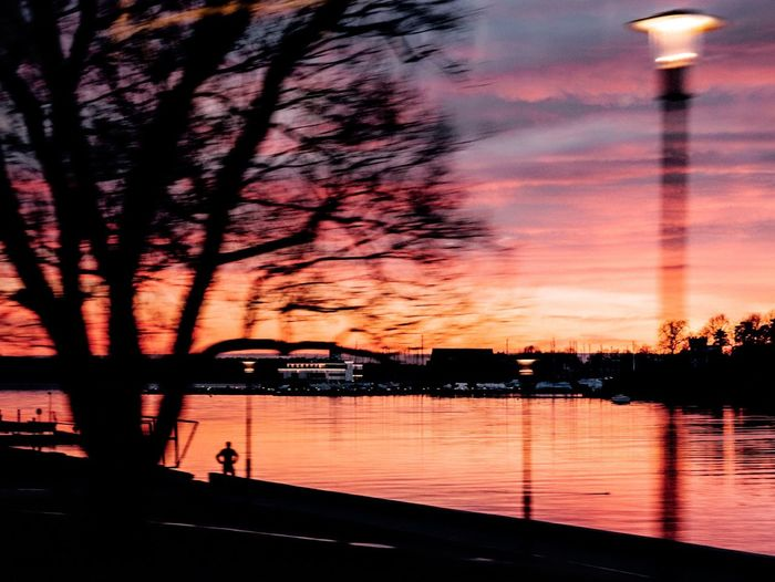 Stopped to watch Sunset Sky Silhouette Water Tree Cloud - Sky Reflection Outdoors Nature Beauty In Nature Scenics River Architecture No People Day 35mm Streetphotography Colors EyeEm Best Shots EyeEmNewHere