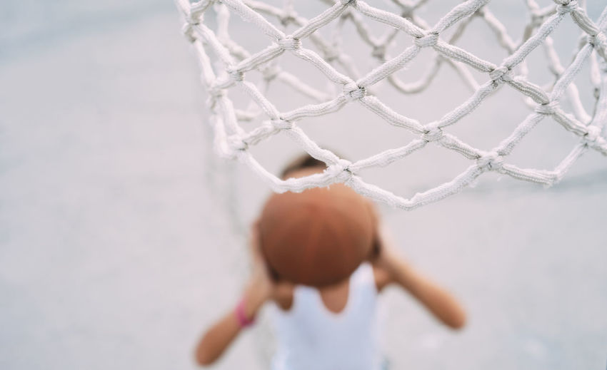 High Angle View Of Boy Playing Basketball