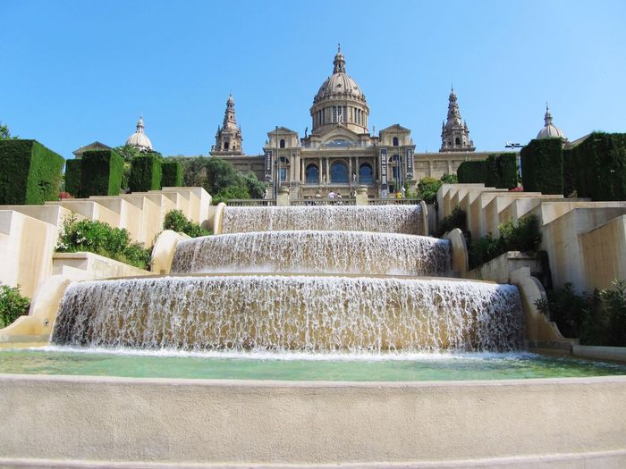 The National Palace of Barcelona with a beuatiful waterfall front- Barcelona, Spain Water Fountain Building Exterior Architecture Motion Built Structure Spraying Travel Destinations Waterfall Outdoors Tourism Clear Sky Sky No People Day Beauty In Nature Nature (null)3XSPUnity Barcelona SPAIN Catalan Barcelona, Spain Palace Historical Building