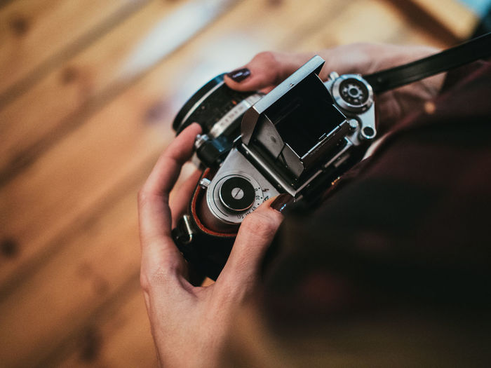 Personal Perspective Of Woman Holding Vintage Camera