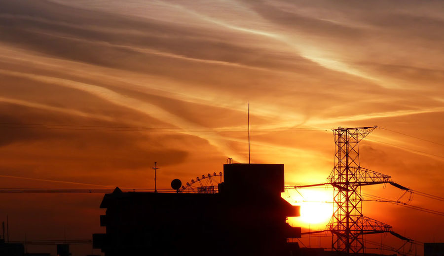High Section Of Silhouette Built Structure Against Sunset