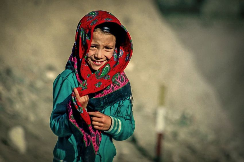 EyeEm Selects Beauty Portrait Portrait Photography Portrait Of A Girl Girl Kid Shy Shygirl EyeEmNewHere EyeEm Best Shots EyeEm Selects EyeEm Gallery Warm Clothing Portrait Smiling Cheerful Happiness Multi Colored Human Hand Red Shawl Headscarf Hijab Religious Dress Islam Village Traditional Clothing Capture Tomorrow Moments Of Happiness It's About The Journey 2018 In One Photograph