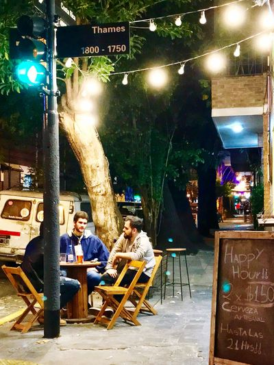 Thames street (PAlermo Bs As) Argentina Palermo Buenos Aires Streetphotography Street Illuminated Night Chair Seat Sitting Table People Cafe Relaxation Adult Men Real People Restaurant Business Food And Drink Group Of People Lifestyles Light