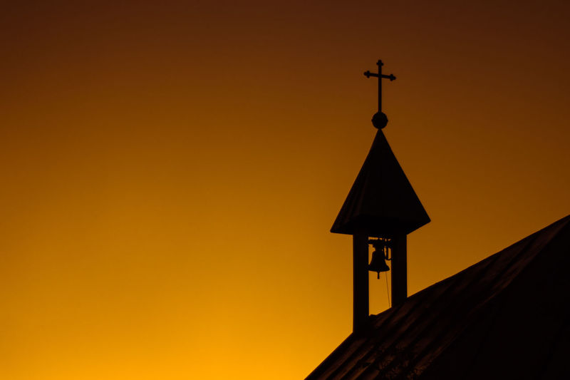Low angle view of church against clear sky during sunset