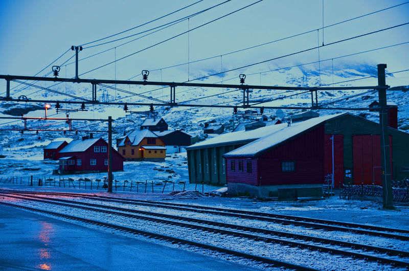 Power Line  Snow Winter Outdoors Power Supply Building Exterior Built Structure Sky House Day Railroad Track No People Architecture Mountain Cold Temperature Finse Norway Night