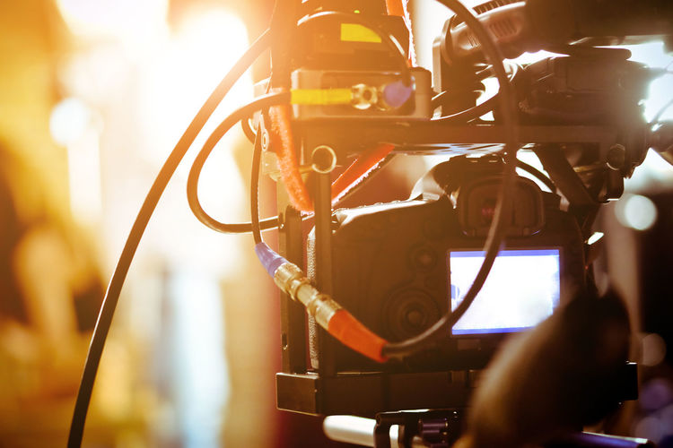 Close-up of television camera in brightly lit room