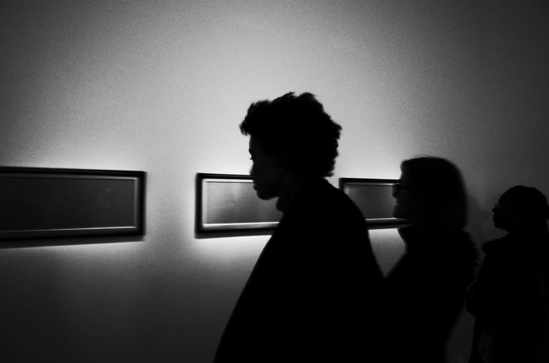 Indoors  Real People Standing Leisure Activity Women Lifestyles Men One Person Illuminated Day People Museum Gallery Art Silhouette Blackandwhite Culture Life Arts Culture And Entertainment Art, Drawing, Creativity