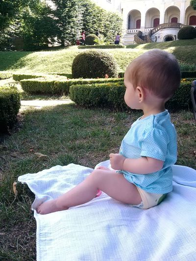 my baby Castle Garden Garden Garden Architecture Sitting Outside Sitting Alone Sitting In The Park On The Ground On The Grass Childhood Child Relaxing Time Full Length Sitting Baby Grass Babyhood Baby Clothing One Baby Girl Only Babies Only 0-11 Months
