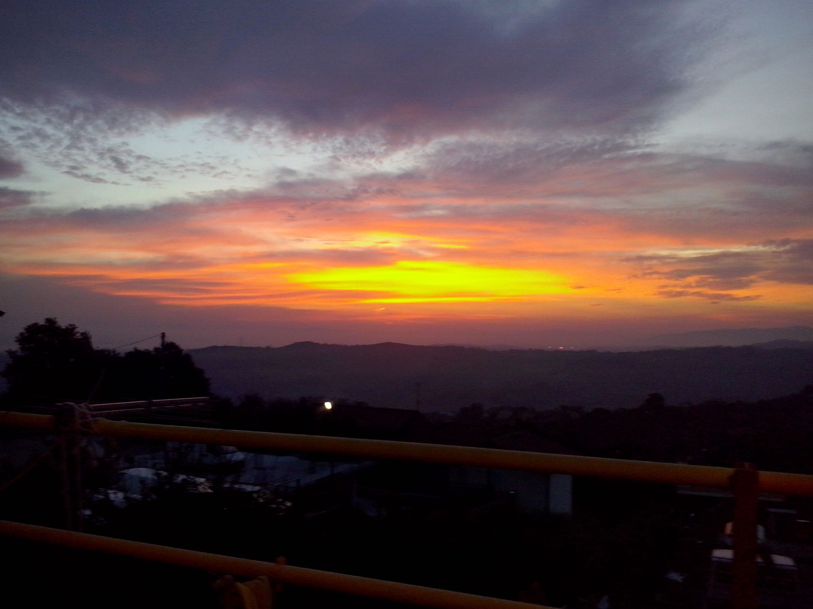 sunset, sky, scenics, cloud - sky, beauty in nature, orange color, tranquil scene, tranquility, silhouette, nature, mountain, idyllic, railing, landscape, dramatic sky, cloud, cloudy, dusk, water, built structure