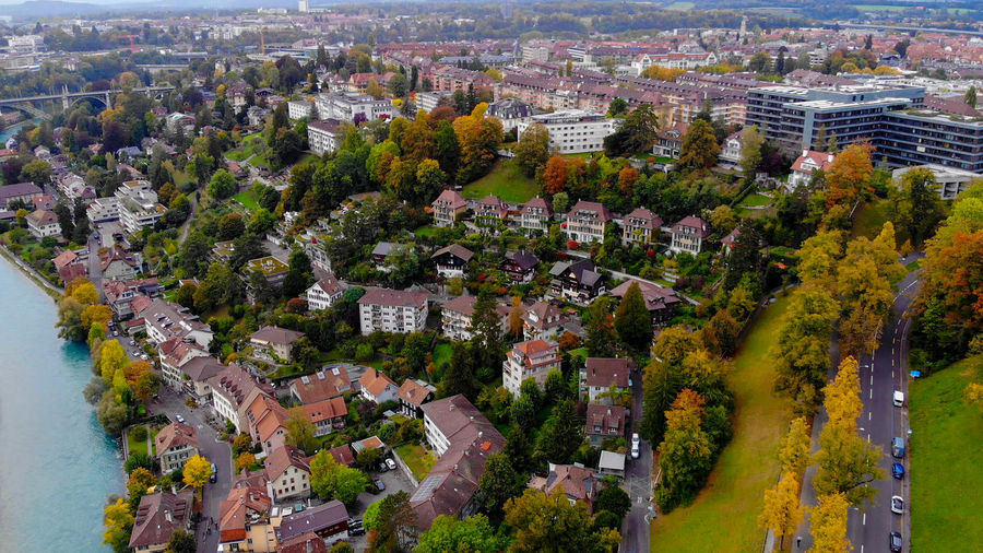 High angle view of townscape and trees in city