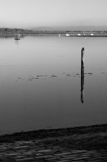 Post Interference Black & White Hayling Island  Beauty In Nature Blackandwhite Day Horizon Over Water Nature No People Outdoors Reflection Scenics Sea Sky Tranquility Water Wooden Post