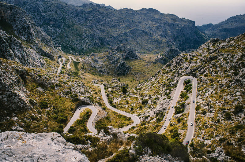 Winding road to Sa Calobra, Mallorca Hiking Mallorca Motorcycle SaCalobra Schlangenstraße Wanderlust Beauty In Nature Cruising Curve Day Environment Formation High Angle View Landscape Mallorcaphotographer Mountain Mountain Range Mountain Road Nature No People Non-urban Scene Outdoors Plant Road Scenics - Nature Tranquil Scene Tranquility Tree Winding Road