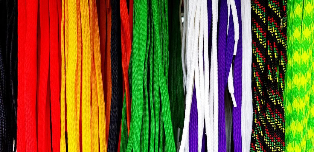 Full frame shot of multi colored shoelaces in store