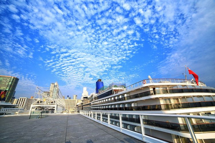 海上風雲 Vessels In Port Vessel Cruise Ship Flag Architecture Patriotism Outdoors Cloud - Sky Sky Building Exterior Built Structure Day No People City Tree Nature Cityscape