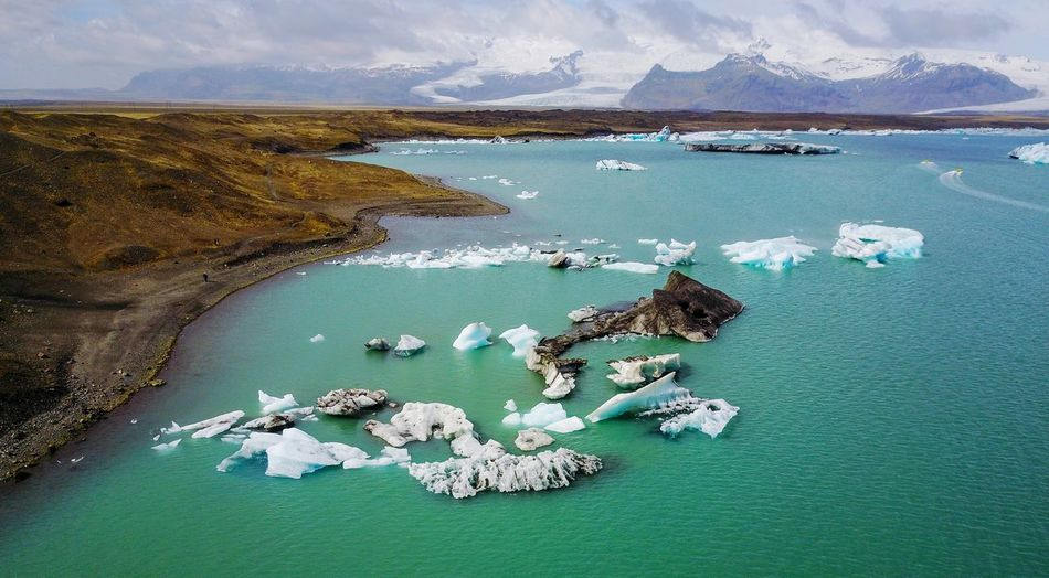 drone view of Jokulsarlon, Iceland EyeEm Gallery Travel Traveling Landscapes Landscape_Collection On The Road Beauty In Nature Nature Nature_collection Naturelovers Nature Photography EyeEm Nature Lover Eye4photography  DJI Mavic Pro EyeEm Best Shots Drone  Dji Dronephotography Droneshot Cold Temperature Jökulsárlón Iceland Glacier Mountain Aerial View High Angle View Landscape Horizon Over Water Iceberg Iceberg - Ice Formation