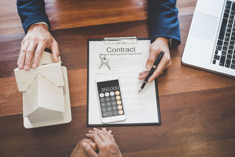 Human Hand Hand Pen Communication Men Indoors  Paper High Angle View Human Body Part Technology Holding Business Connection Adult Banking Insurance Home Loan Ownership Landlord Agreement Contract Signing Key Agency Marketing