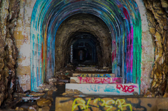Tunnel vision Multi Colored Architecture Built Structure Steps Arch No People Indoors  Tunnel Santa Cruz Backgrounds Davenport  Creative Light And Shadow Dark Tunnel Vision Graffiti Art Graffitiart Textures POV Graffiti Exposure Longexposure Tunnel View Tunnels Tunnelvision