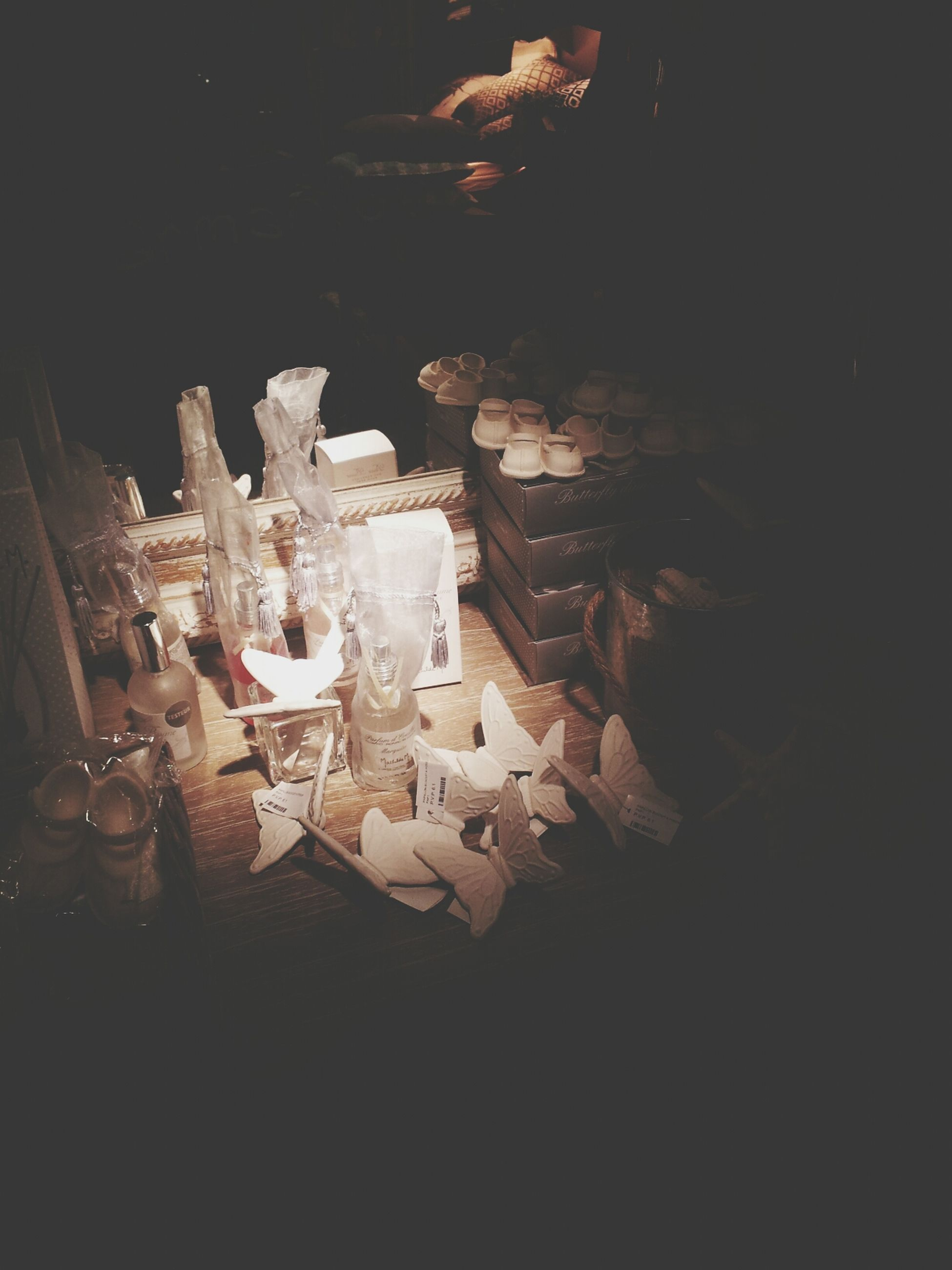indoors, table, still life, candle, dark, high angle view, burning, night, flame, no people, illuminated, wood - material, arrangement, large group of objects, chair, heat - temperature, fire - natural phenomenon, close-up, home interior, food and drink