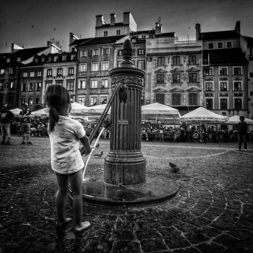 Small girl and old water well , old town Vacations Tourist Attraction  Romantic Landscape barefoot Well  Water Building Exterior Architecture Built Structure Full Length One Person Real People City Building Exterior Architecture Built Structure Full Length One Person Real People City Standing Rear View Women Childhood Building Child Lifestyles Leisure Activity Day Outdoors My Best Travel Photo