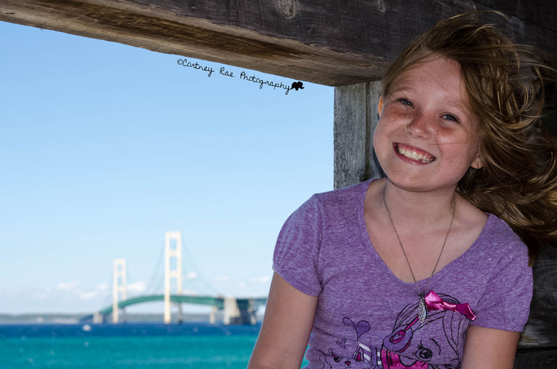Capturing Freedom Lakemichigan Puremichigan Cortney Rae Photography Color Portrait Childphotography PortraitPhotography MackinacBridge Beautiful Enjoying Life