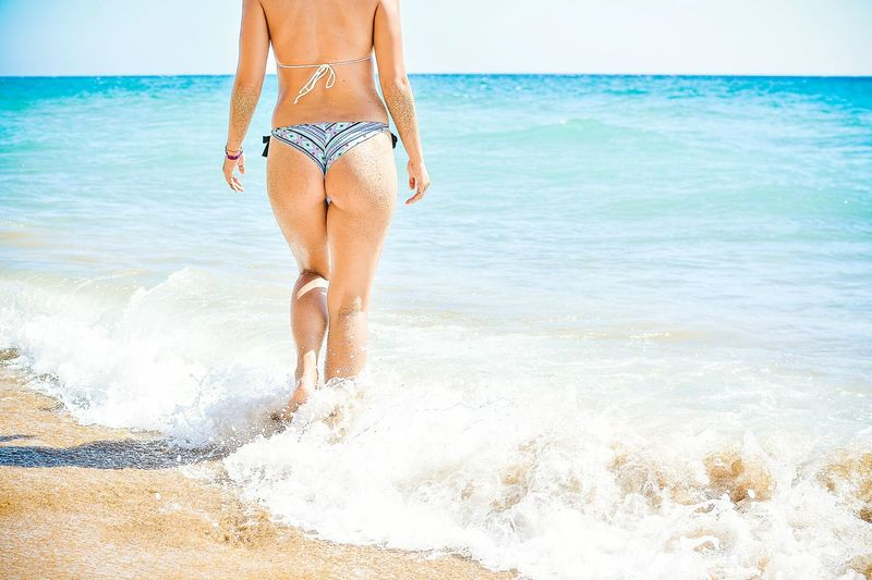 Low section of woman on beach