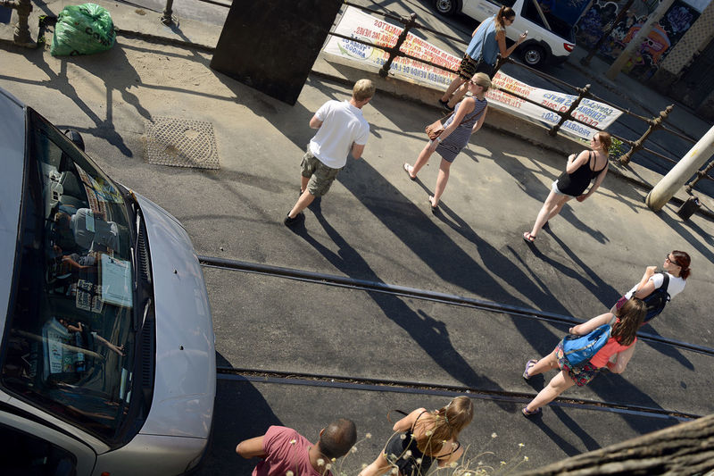 High Angle View Of People Passing By Tramway