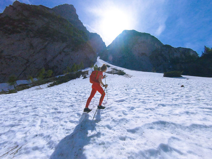 Man on snowcapped mountains against sky